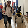 A student with Astro the robo dog