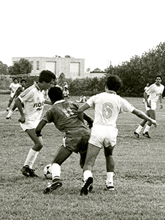 Photograph of FAU men's soccer team players during a game