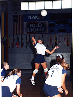Photograph of players from the FAU volleyball team during a game
