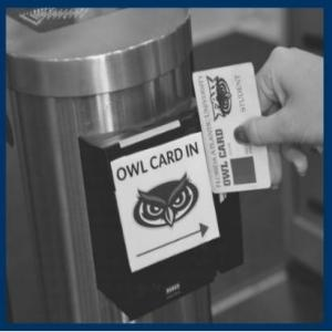 Someone swiping Owl Card to enter building